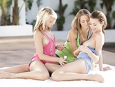 Young Friends Covered In Slippery Baby Oil Outdoors